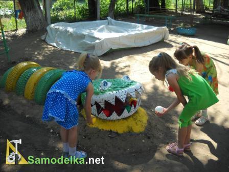 Как сделать детскую площадку из покрышек.