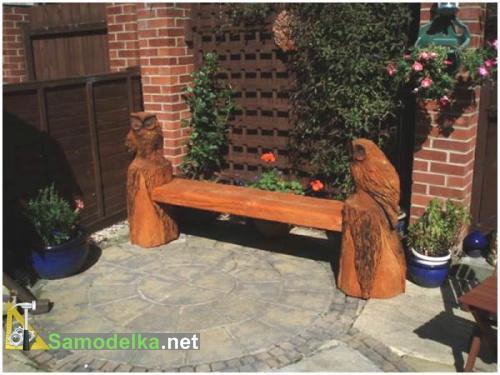 резная скамейки из дерева с двумя совами фото