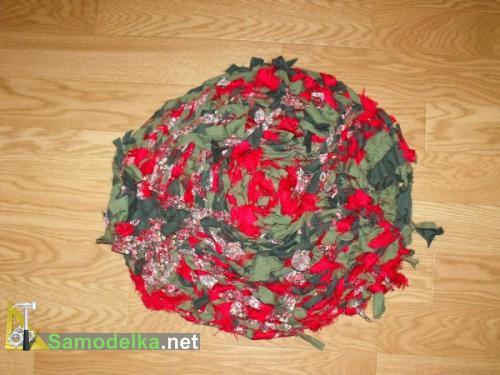 Самодельный шитый коврик из сплетенных косой лент