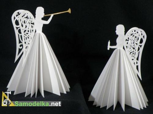 ангел из журнала с бумажными крыльями