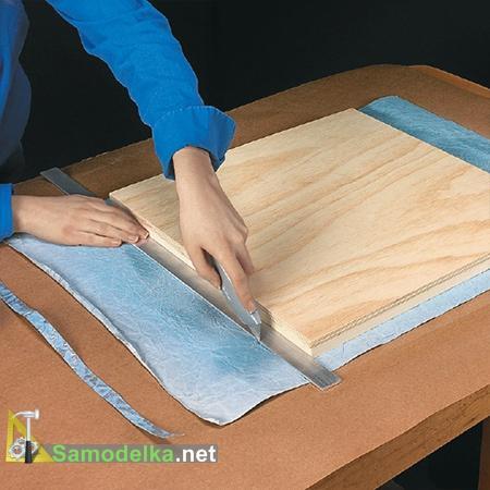 Обрезаем лишнюю бумагу с рамки